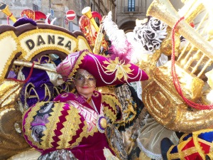Costumed reveler in Valletta's Carnival celebration